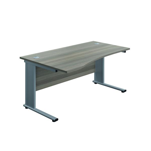 Jemini Double Upright Metal Insert Left Hand Wave Desk 1600x1000mm Grey Oak/Silver KF816039